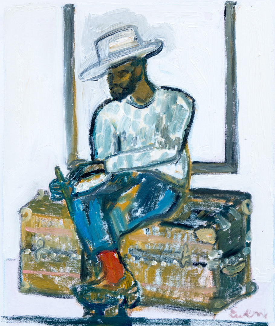 Handsome Man In Hat (Sitting On Trunk)