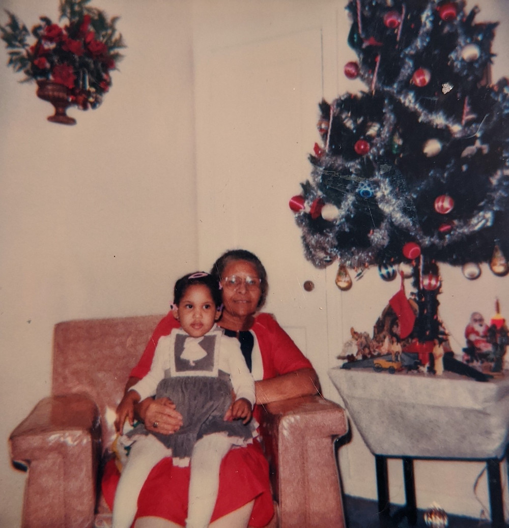 The author as a child sits on her great-grandmother's lab, with Christmas decorations
