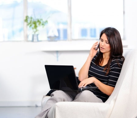 Blog-pic-woman-on-cell-laptop-10802986.j