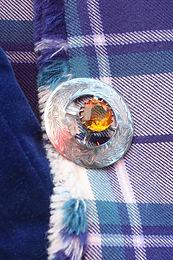Tartan with brooch.jpg