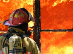 Flames in Window of Structure Fire