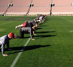 Push-ups on the 50 yard-line