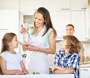 Mother and children with carafe water in