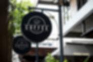 Black sign outside a restaurant mockup.j