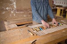 Carpenter Organizing his Tools
