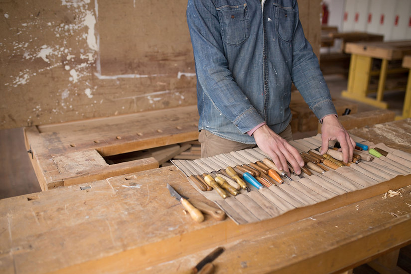 Carpenter Organizing his Tools