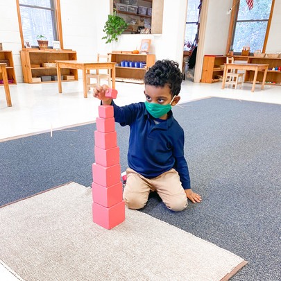Deep in Concentration Building the Pink Tower