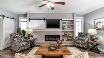 Living Room with Barn Door Entertainment Center and Electric Fireplace