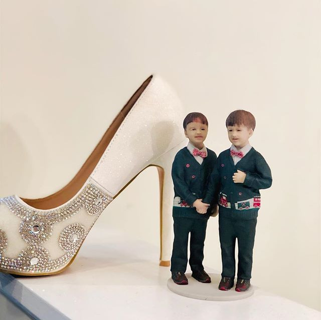 These little boys got a cute figurine of