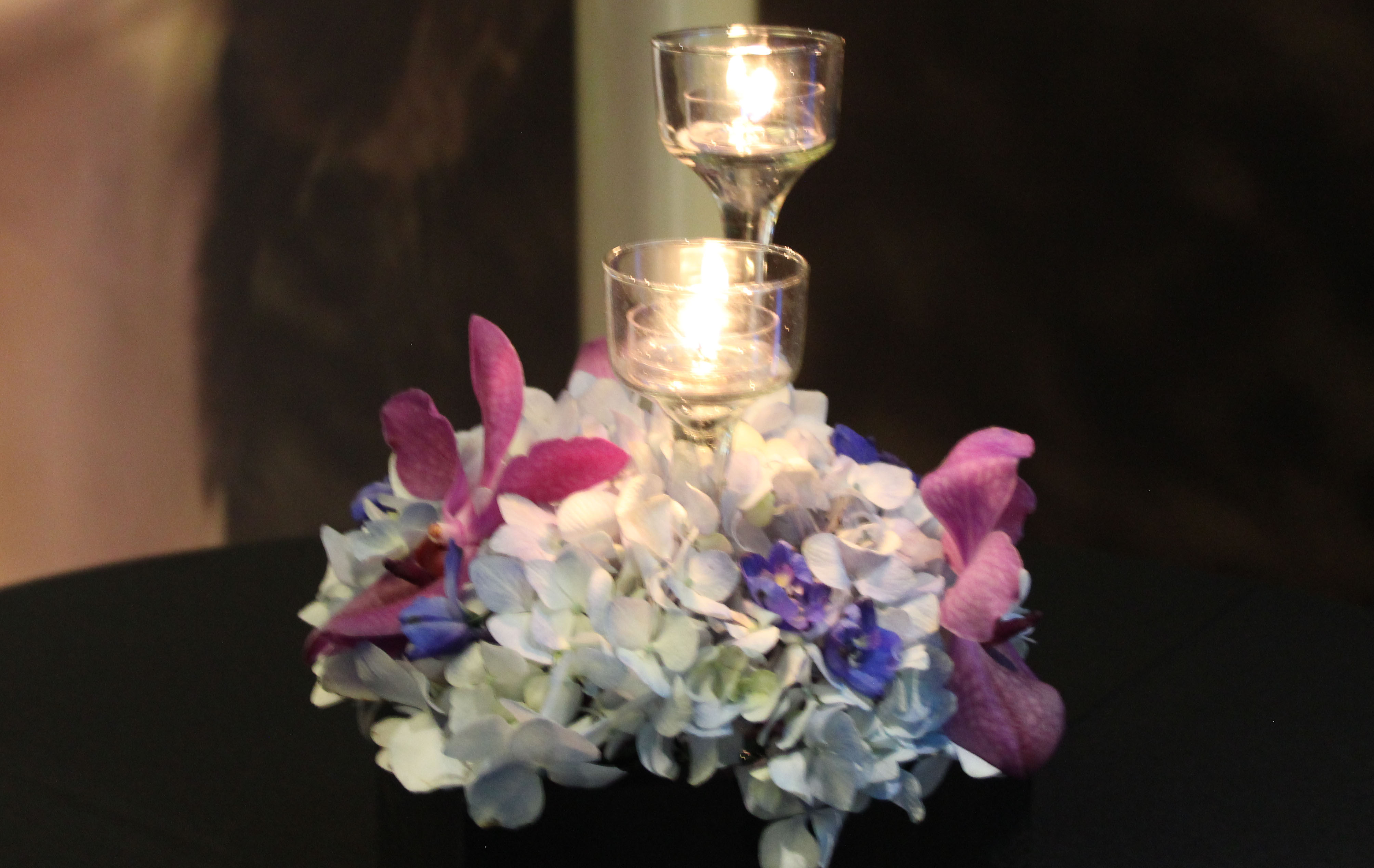 white, hot pink, purple candle centerpiece- Party Planner Denver