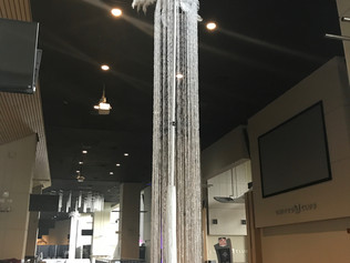 20 ft tall crystal column with feathers