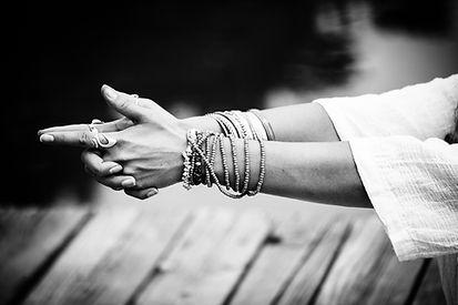 woman hands in yoga symbolic gesture mud