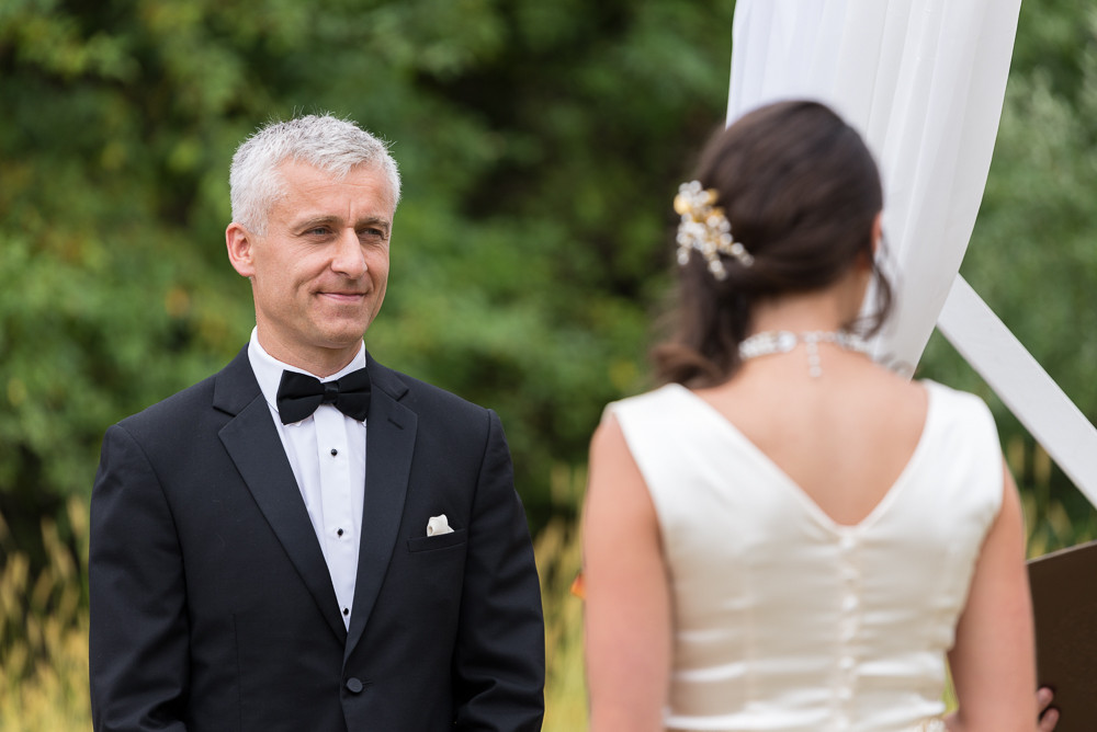 Andreas admires his bride during the ceremony