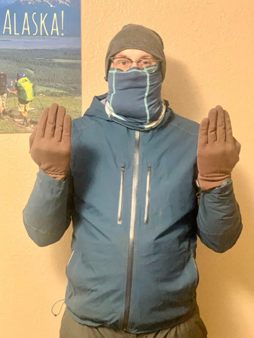 Go Hike Alaska guide Matt demonstrating proper protection of the extremities in cold weather.