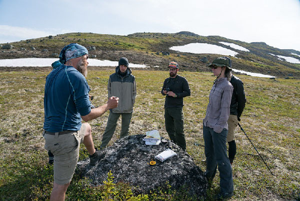 Go Hike Alaska guide Matt and guests learning to navigate by map at K'esugi Ridge
