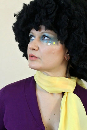 Very traditional 70's Disco era, time makeup look, bright blue, gliiter with stars