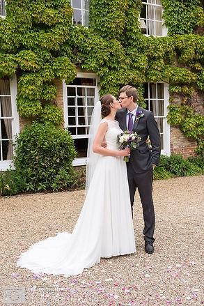 Bride kissing Groom, Husband and Wife, newlyweds, bridal, wedding makeup