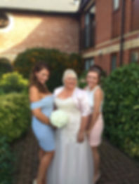 Happy bride with her nieces with a classic Bridal makeup, white dress