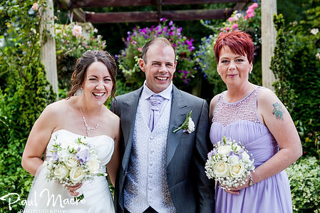 Happy bride to be and groom and maid of Honour with flower buquets posing. Beautiful wedding glam makeup