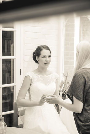 Final touches for makeup, when the bride is in her dress