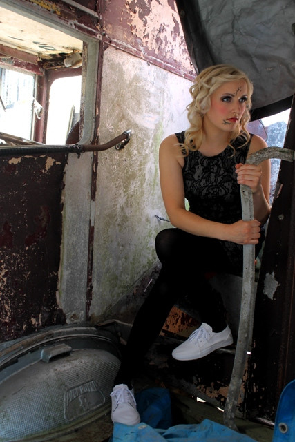 Broken_doll_sitting_in_an_old_bus_haunting_you_makeup_cracks.JPG