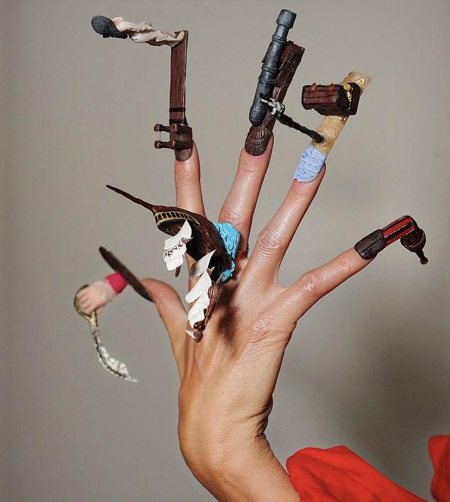 #9-Top-10-most-crazy-unusual-nail-art-designs-pirates-guns-hats-adventure.jpg