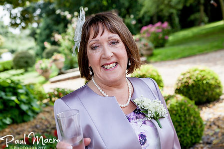 Proud mother of a Bride, elegant, glam makeup look, purple outfit