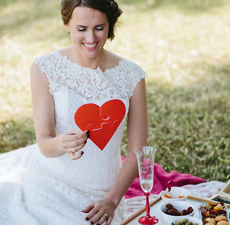 Classic Wedding, bridal Makeup look. Bride during her wedding picnic with love heart puzzle