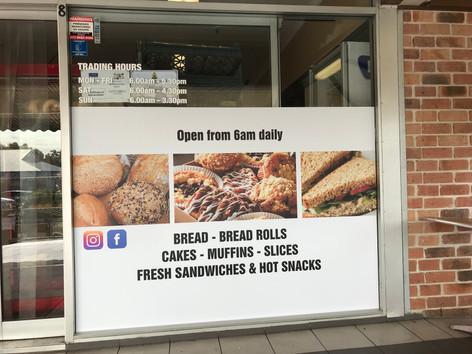 shopfront stickers advertising cafe bakery
