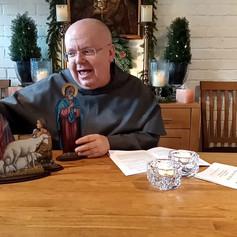 Pater Joseph Maria presenterar Julkrubban