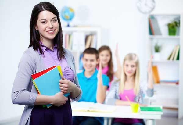 happy-teacher-with-students-background_1