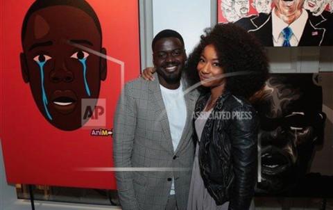 Daniel Kaluuya (Chris) and Betty Gabriel (Georgina) standing in front of my piece.