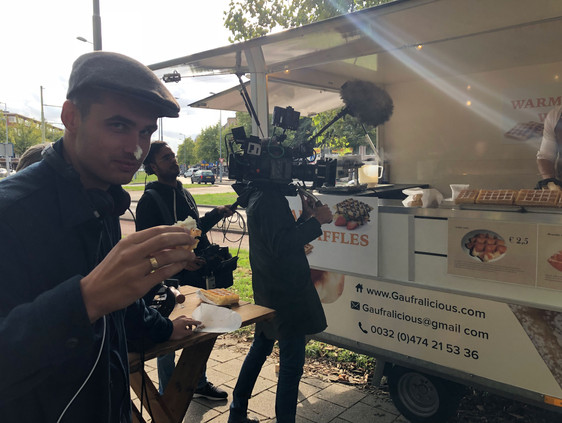 DIRECTOR FABIO DE FREL TRIES TO EAT A WAFFLE ON THE CHESTERFIELD SET