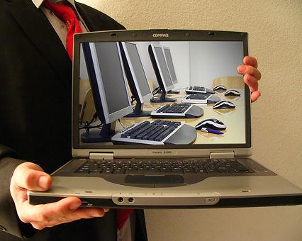 holding-laptop-1552142.jpg