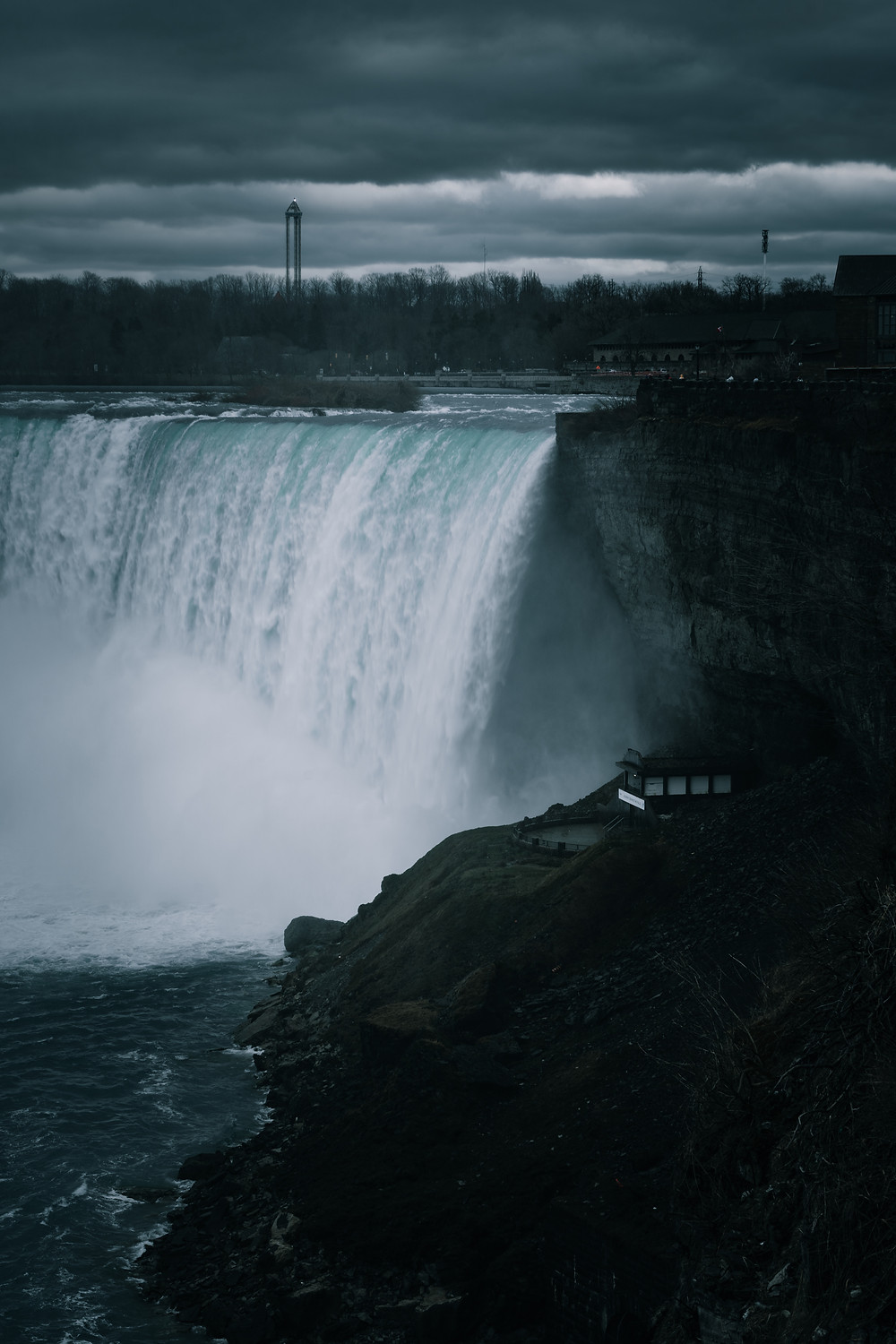 Quick shutter speed to capture the falls. Sony, Canon, Pentax, Fuji and Nikon can all shoot this photo as well.
