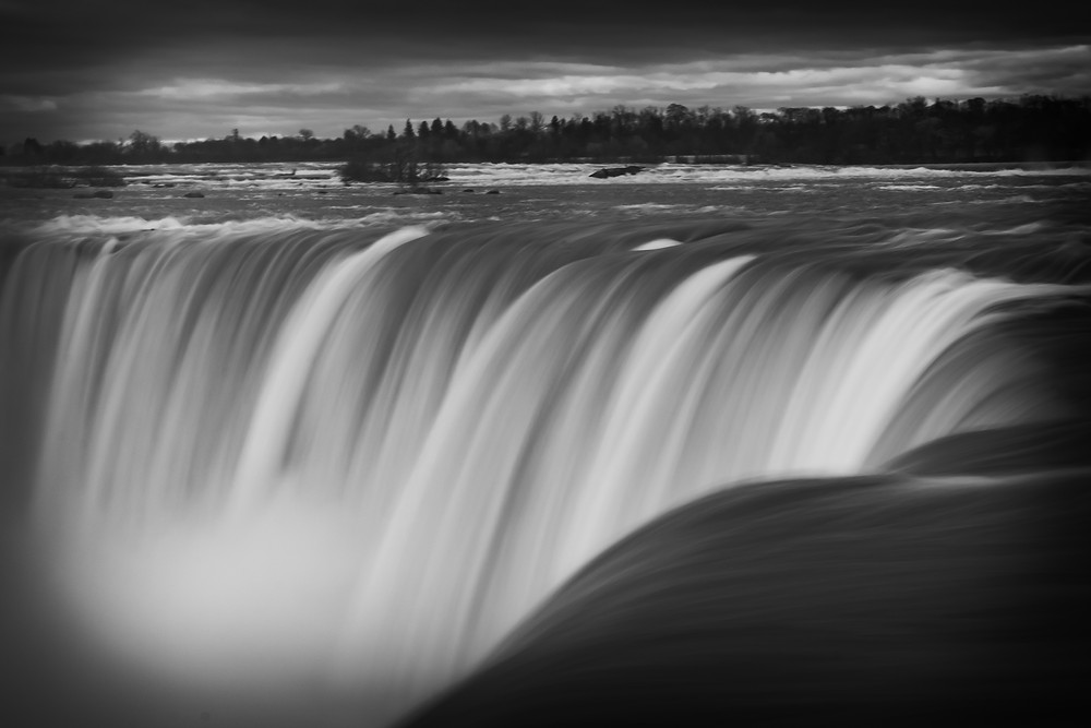 Close up of the Niagara Falls in black and white. Photo credit to Mr. Brian James.