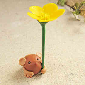 Tiny mouse miniature with yellow buttercup