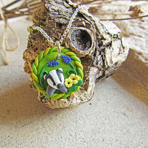 Baby badger necklace with primroses and hyacinths
