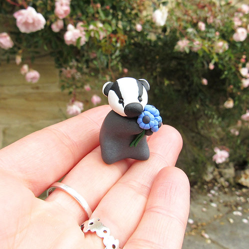Cute badger ornament with blue flowers