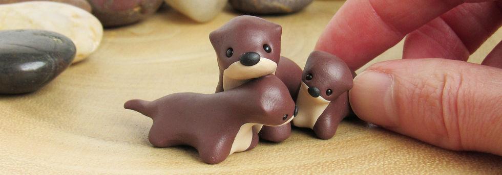 Otter family strip.jpg