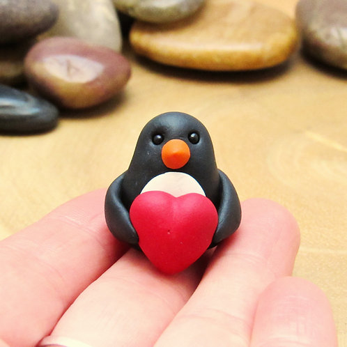 Penguin ornament with heart