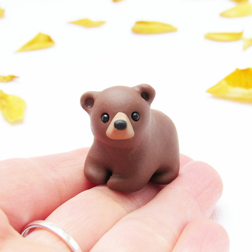 Tiny grizzly bear ornament
