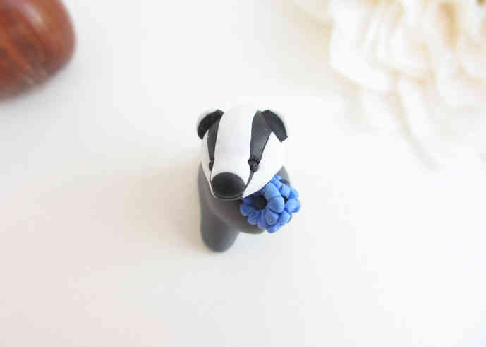 Badger miniature with blue flowers