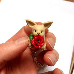 Tiny rabbit ornament with a rose