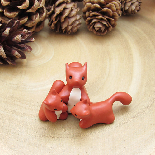 Tiny red squirrel ornament