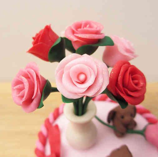 Rabbit and roses cake decoration