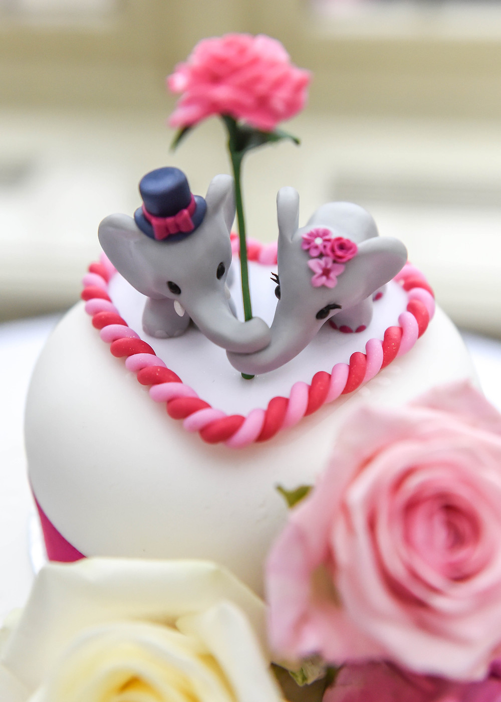 Elephant wedding cake topper with pink rose