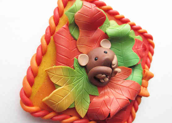 Dormouse in Autumn leaves wall plaque