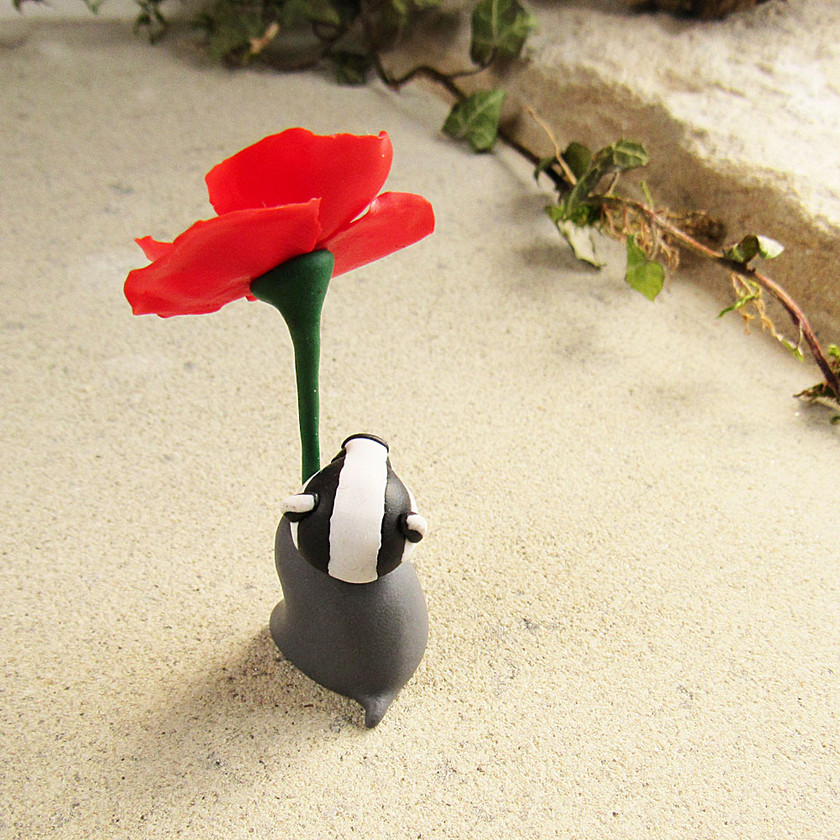 Badger ornament with red poppy