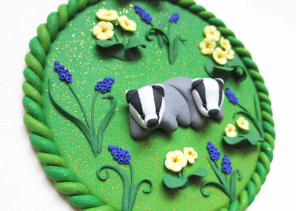 Baby badgers in primroses and hyacinths wall art miniature plaque